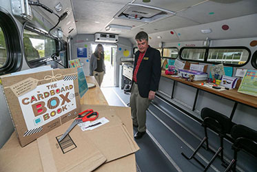 Jim Wright, with the Bagwell College of Education at Kennesaw State University, tours the inside of the school's new iTeach MakerBus as Education Technology Specialist Felicia Belcher explains the stations inside on Wednesday at the Kennesaw campus.